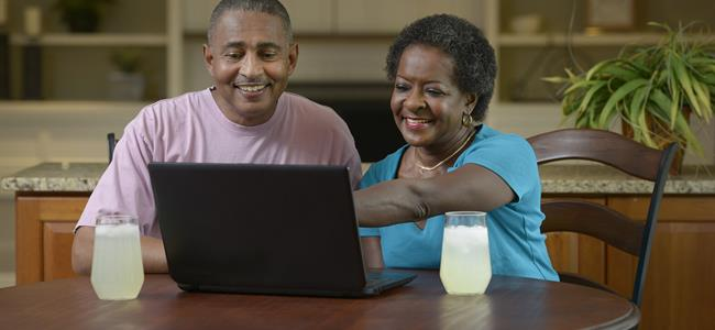 Couple uses a computer